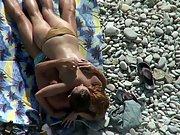 Sexy nude bitch ravaging on a pebble beach voyeur sex video