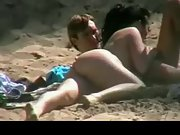 Booty bare girlfriend gargling her boyfriend's big trouser snake at the beach
