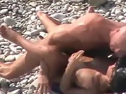 Bald stud pounds his sexy babe on the beach