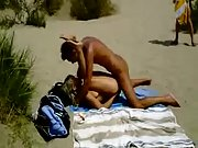 Lucky voyeur films naughty amateurs having beach hookup