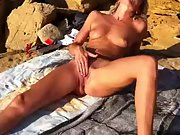 Horny wife with sexy lengthy gams jerking hard at the beach