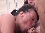 Mature wife guzzling stranger's jizm at a naturist beach