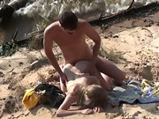 Naked couple has sex on the beach while flaps lap at their soles