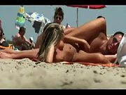 Wonderful blonde stunner gets caught toying with her boy's cumbot at the nudist beach